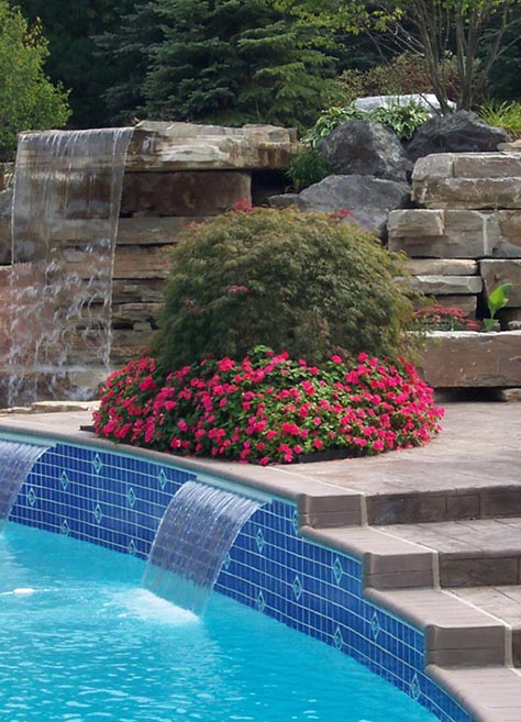 Outdoor Living Spaces, Landscaped in-ground pool with waterfall